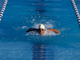 Male Swimmer Competing in a Butterfly Race Photographic Print