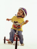 4 Year Old Boy Posing on His Tricycle, New York, New York, USA Photographic Print by Paul Sutton