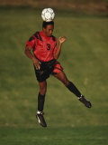 Soccer Player in Action Heading the Ball Photographic Print