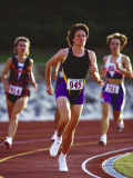 Female Runners Competing in a Track Race Photographic Print
