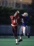 American Football Player Reaching for the Ball Photographic Print