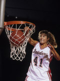 Female Basketball Player Dunking a Ball Through the Hoop Photographic Print
