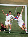 Soccer Players Celebrating after Scoring a Goal Photographic Print