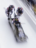 Blurred Action of the Start of 4 Man Bobsled Team Photographic Print