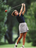 Woman Golfer in Action Photographic Print by Chris Trotman