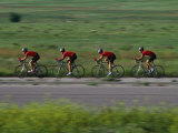 Road Cycling Team in Action Photographic Print