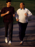 Father and Son Running Togerther for Exercise, New York, New York, USA Photographic Print by Paul Sutton