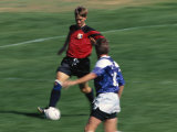 Blurred Action of Male Soccer Player Photographic Print