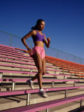Woman Training on Stadium Stairs Photographic Print