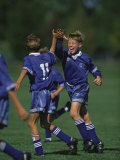 11 Year Old Boys Soccer Player Celebates a Goal Photographic Print