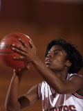 Female High Schooll Basketball Player in Action Shooting a Free Throw During a Game Photographic Print