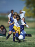 8 Year Old Girls in Action Durring Soccer Game, Lakewood, Colorado, USA Photographic Print