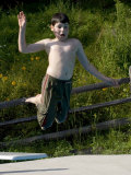9 Year Old Boy Jumping into a Swimming Pool, Woodstock, New York, USA Photographic Print by Paul Sutton