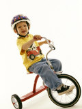 Portait of Four Year Old Boy on His Tricycle Photographic Print by Paul Sutton