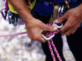 Climber Adjusting Carribiner and Rope, New Paltz, New York, USA Photographic Print by Paul Sutton