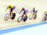 Blurred Action of Cyclist on the Track Fotoprint van Chris Trotman