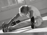 Man Stretching in Gym, New York, New York, USA Photographic Print by Chris Trotman