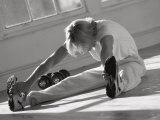 Man Stretching in Gym, New York, New York, USA Photographic Print by Chris Trotman