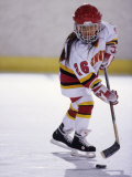 Young Girl Playing Ice Hockey Photographic Print