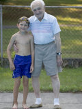 96 Year Old Grandfather with 9 Year Old Grandson at Poolside, Kiamesha Lake, New York, USA Photographic Print by Paul Sutton