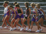 Female Runners at the Start of a Track Race Photographic Print