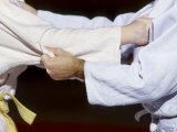 Detail of the Hands of Judo Competitors in Action Photographic Print