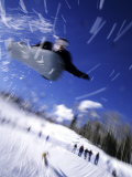 Male Snowboarder Flying Throught the Air, Aspen, Colorado, USA Photographic Print
