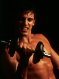 Man Working Out with Hand Weights Photographic Print by Chris Trotman