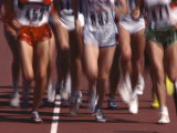 Blurred Action of Women Runners During a Track Race Photographic Print by Steven Sutton