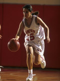 Teenage Girs Playing High School Basketball Photographic Print