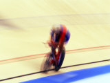 Blurred Action of Cyclist on the Track Photographic Print by Chris Trotman