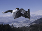 Male Snowboarder Flying over the Vert Photographic Print