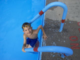 Portrait of 9 Year Old Boy Swimming in Pool, Kiamesha Lake, New York, USA Photographic Print by Paul Sutton