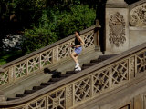 Hispanic Woman Running for Exercise, New York, New York, USA Photographic Print by Paul Sutton