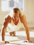Young Man Preforming Push Up Exercise in Gym Photographic Print by Chris Trotman