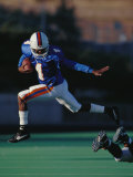 Football Player in Action Photographic Print