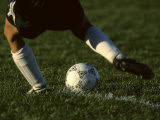 Detail of Foot About to Kick a Soccer Ball Photographic Print by Paul Sutton