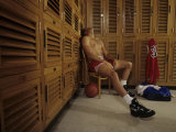 Man Resting in Locker Room after Basketball Workout, USA Photographic Print