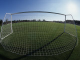 View of Soccer Field Through Goal Photographic Print by Steven Sutton