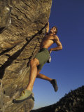Rock Climber Hanging from Grip Photographic Print