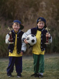 Two Young Brothers Posing with their Soccer Trophies Photographic Print by Paul Sutton