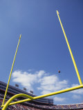 American Fooball Flying Through the Goalposts Photographic Print