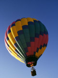 Hot Air Balloon in Flight Photographic Print by Paul Sutton