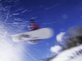 Blurred Action of Snowboarder in Flight, Aspen, Colorado, USA Photographic Print