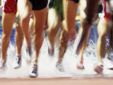 Runners Legs Splashing Through Water Jump of Track and Field Steeplechase Race, Sydney, Australia Fotografie-Druck von Paul Sutton