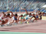 Blured Action at the Start of a Mens 100 Meter Track and Field Race Photographic Print by Paul Sutton