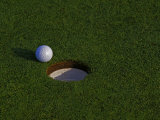Golf Ball Sitting Near the Hole Photographic Print