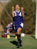Soccer Player Reacts with Joy after Scoring a Goal Photographic Print