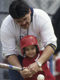 Dad Coaching His Son During a Tee Ball Game Photographic Print