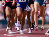 Detail of Runners Legs Competing in a Race Fotografie-Druck